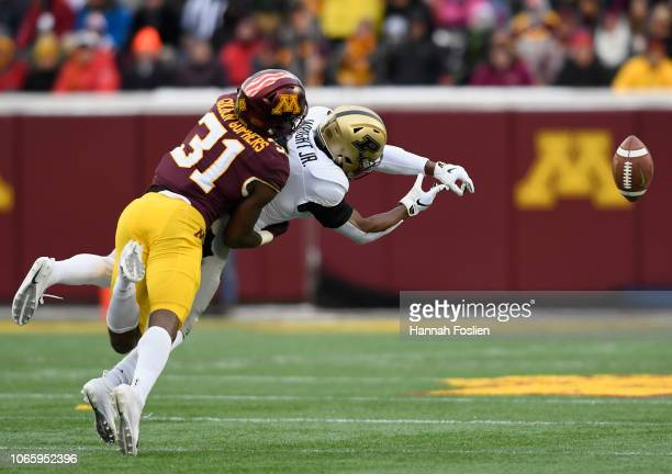 Kiondre Thomas of the Minnesota Golden Gophers breaks up a pass intended for Terry Wright of the Purdue Boilermakers during the second quarter at...