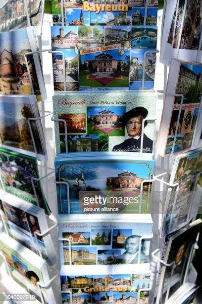 Kiosk offers Wagner postcards in front of the Festival Theatre on the Green Hill in Bayreuth, Germany, 16 August 2013. Photo: David Ebener | usage...