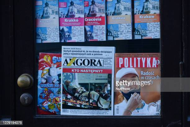Kiosk's window with magazines and maps for sale, including the latest Polityka's front page with an image of Polish young tennis champion, Iga...