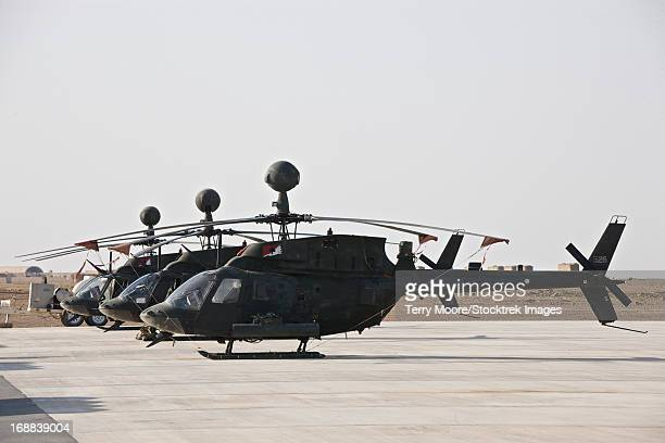 OH-58D Kiowa helicopters on the flight line at COB Speicher, Tikrit, Iraq, during Operation Iraqi Freedom.