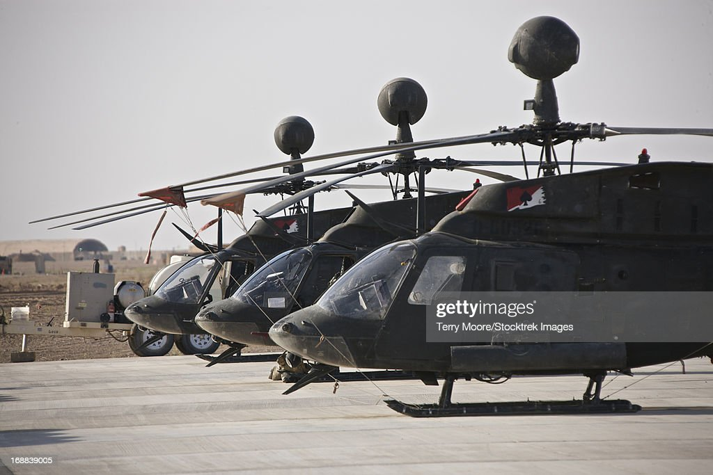OH-58D Kiowa helicopters on the flight line at COB Speicher, Tikrit, Iraq, during Operation Iraqi Freedom. : Stock Photo
