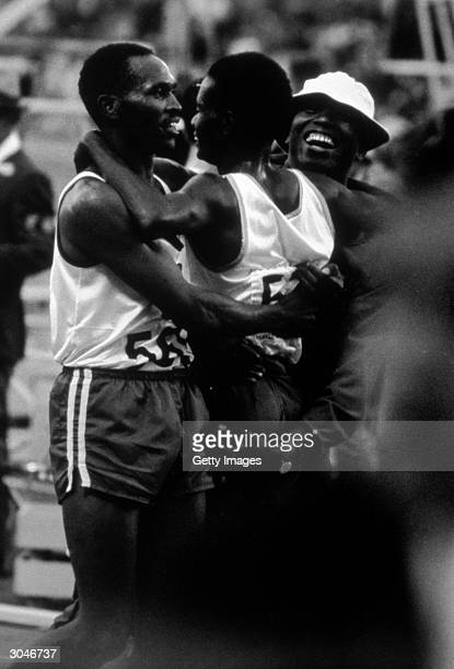 Kip Keimo Ken hugs Maftali Temu of Kenya who won the Men's 10,000m during the XIX Olympic Games on October 15, 1968 in Mexico City, Mexico.