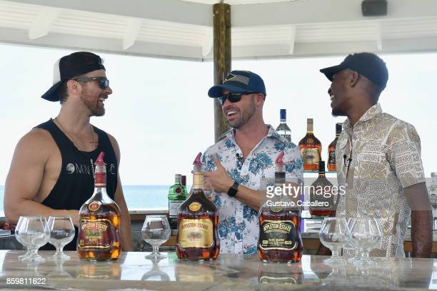Kip Moore and Cody Alan with bartender Fitzroy at the Rum tasting at Latitudes for Story Behind The Songs LIV Concert Event At Sandals South Coast on...