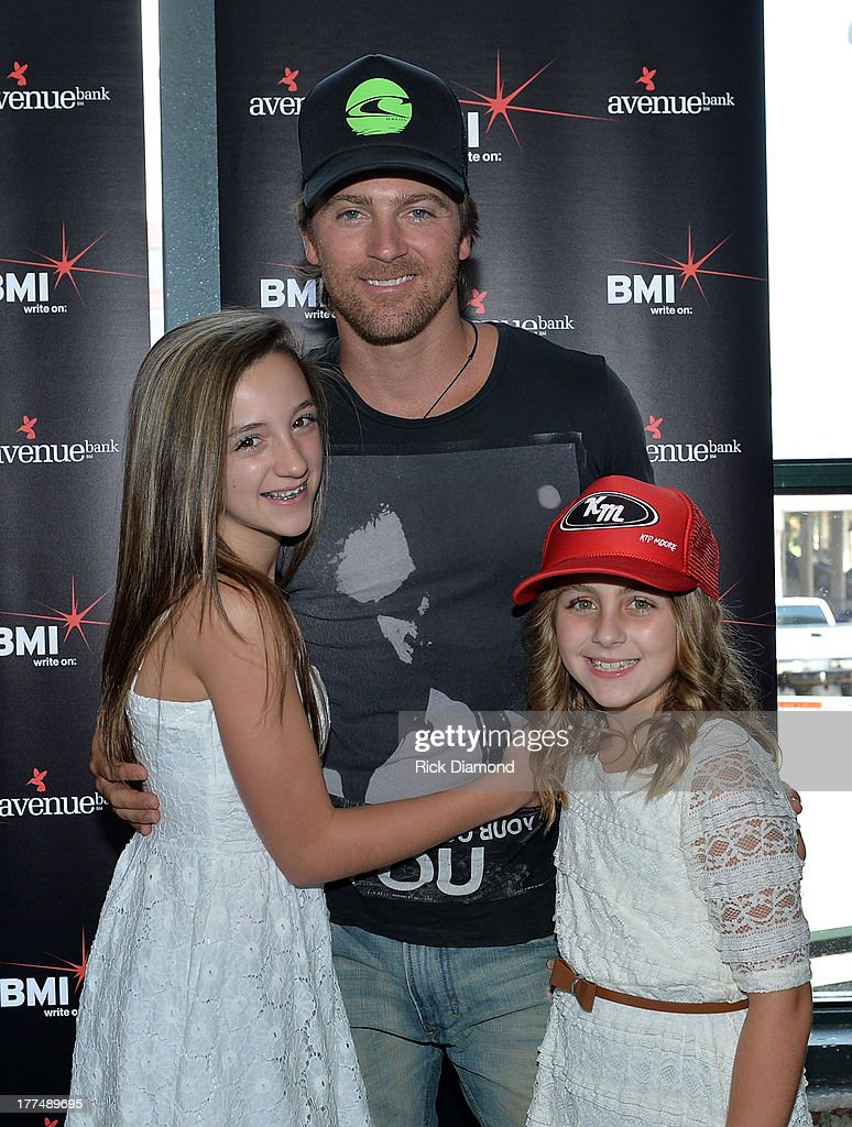 Kip Moore and family members attend the BMI #1 Party For 'Hey Pretty Girl' By Kip Moore at Flying Saucer Draught Emporium on August 22, 2013 in Nashville, Tennessee.