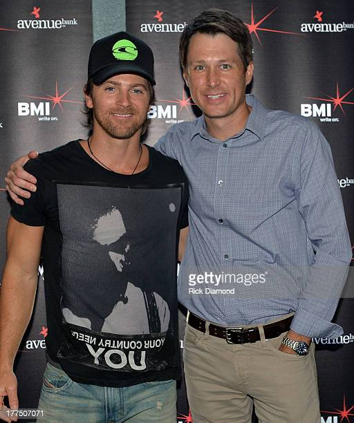 Kip Moore and Marc Dennis CAA attend the BMI Party For Hey Pretty Girl By Kip Moore at Flying Saucer Draught Emporium on August 22 2013 in Nashville...