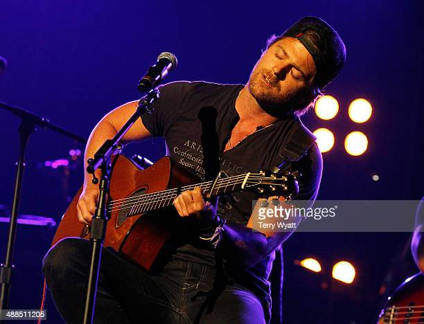 Kip Moore performs on stage during Keith Urban's Fifth Annual We're All 4 The Hall Benefit Concert at the Bridgestone Arena on May 6 2014 in...
