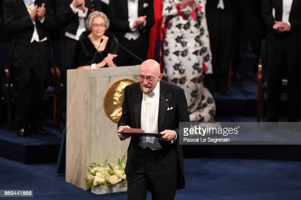 Kip S Thorne laureate of the Nobel Prize in physics acknowledges applause after he received his Nobel Prize from King Carl XVI Gustaf of Sweden...