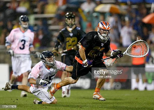 Kip Turner of Supernova tries to stop Brett Queener of Eclipse during the 2013 Major League Lacrosse All Star Game at American Legion Memorial...