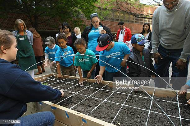 Kipp Co-Principal Stephanie Adams and KIPP Infinity Charter School students attend the American Heart Association Teaching Gardens Planting in Harlem...