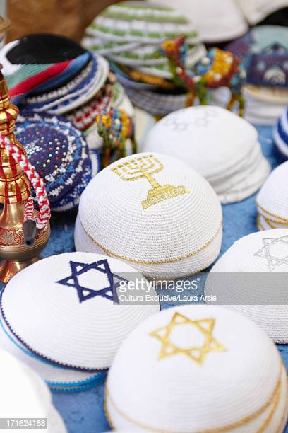 kippahs in bazaar in safed, israel - safed stock photos and pictures