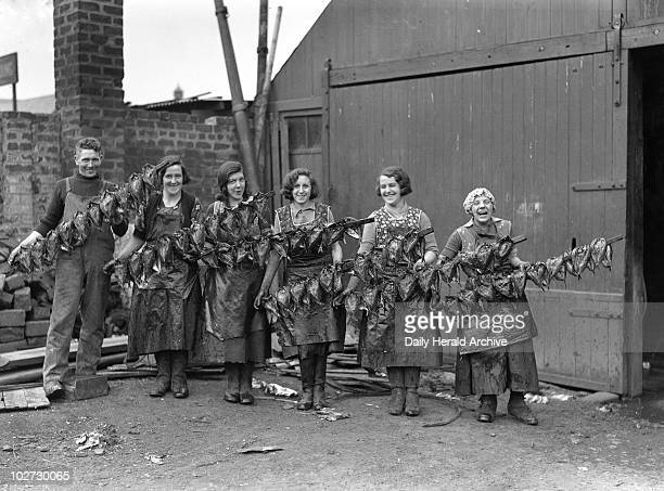 Kipper girls displaying smoked kippers 24 September 1931 Kipper girls displaying smoked kippers Newhaven Edinburgh Scotland This photograph was taken...