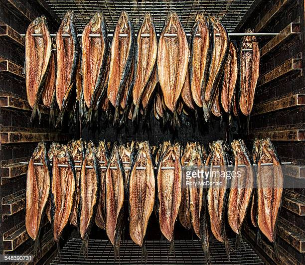 Kippers hanging in a smoker