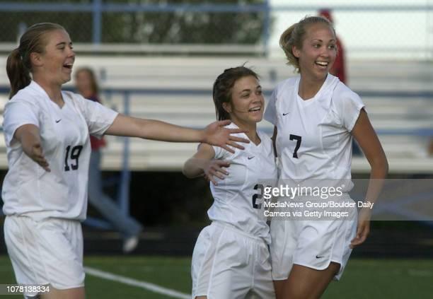 Kira Brannan left Amanda Kafer and Jenna Kaiser Broomfield High School celebrate Kafer's goal in the first half of play Wednesday at Elizabeth...