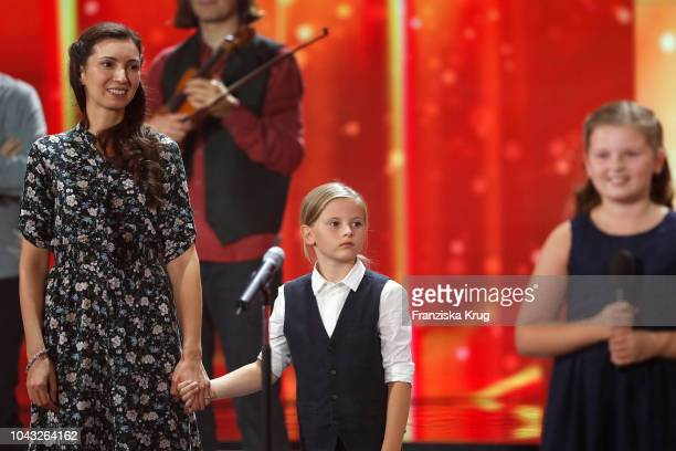 Kira Harms Kelly Joseph Ewan Gregory Walter Kelly and Mary Emma Kelly perform during the television show 'Willkommen bei Carmen Nebel' at Velodrom on...