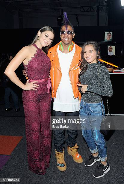 Kira Kosarin Nick Cannon and Isabela Moner pose backstage during the 2016 Nickelodeon HALO awards at Basketball City Pier 36 South Street on November...
