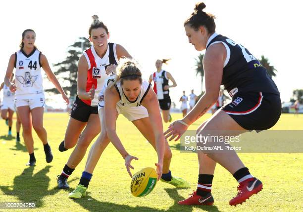 Kira Price of Melbourne Uni and Jasmine Rolland of the Saints compete for the ball during the round 11 VFLW match between the Southern Saints and...