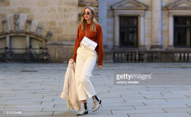 Kira Tolk wearing jacket sweater and trousers from otherstories Chanel bag and Vagabond shoes on February 18 2019 in Hamburg Germany
