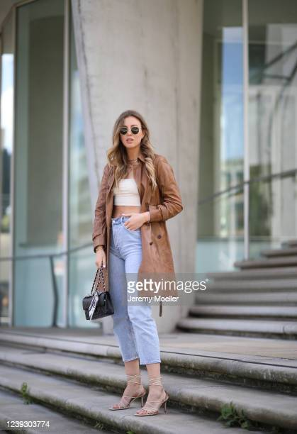 Kira Tolk wearing Levi's jeans Marc Cain coat Leger by about you top and otherstories shoes on May 28 2020 in Hamburg Germany