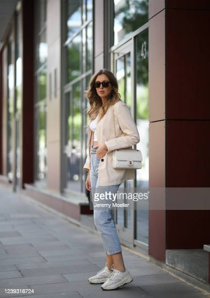 Kira Tolk wearing Levi's jeans, Zara top, Amazon the drop by Milena blazer, Yeezys x Adidas sneaker, Chanel belt and bag and Kapten & Son shades on...