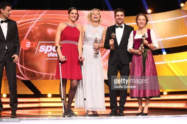 Kira Walkenhorst and her beach volleyball team mate Laura Ludwig Johannes Rydzek and Laura Dahlmeier with award during the 'Sportler des Jahres 2017'...