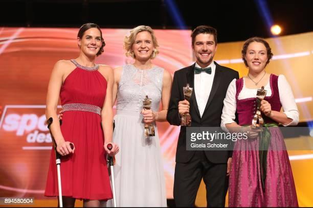 Kira Walkenhorst and her beach volleyball team mate Laura Ludwig Johannes Rydzek and Laura Dahlmeier with award during the 'Sportler des Jahres 2017'...