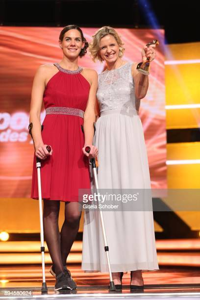 Kira Walkenhorst and her beach volleyball team mate Laura Ludwig with award best team during the 'Sportler des Jahres 2017' Gala at Kurhaus...
