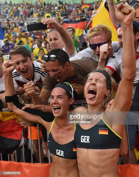 Kira Walkenhorst and Laura Ludwig of Germany celebrate after the Women's Beach Volleyball Semifinal between Rocha / Maestrini of Brazil and Ludwig /...
