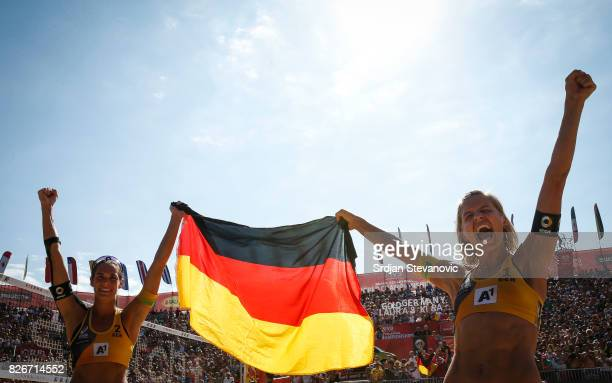 Kira Walkenhorst and Laura Ludwig of Germany celebrate after the Women's Final match between Germany and USA on August 05 2017 in Vienna Austria