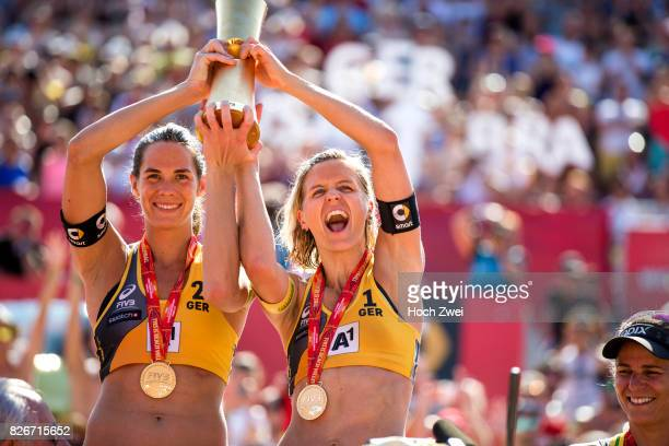 Kira Walkenhorst and Laura Ludwig of Germany celebrate after winning the gold medal match during Day 9 of the FIVB Beach Volleyball World...