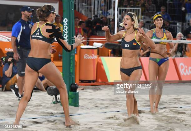 Kira Walkenhorst and Laura Ludwig of Germany celebrate during the Women's Beach Volleyball Final between Ludwig / Walkenhorst of Germany and Agatha /...