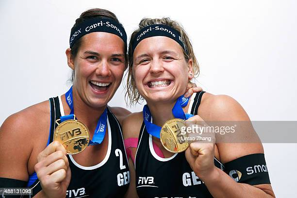 Kira Walkenhorst and Laura Ludwig of Germany celebrate with their gold medals after during the Women's Final match of 2014 FIVB Shanghai Jinshan...
