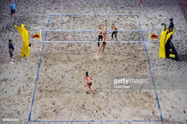 Kira Walkenhorst and Laura Ludwig of Germany compete against Melissa HumanaParades and Sarah Pavan of Canada during Day 3 of the Swatch Beach...