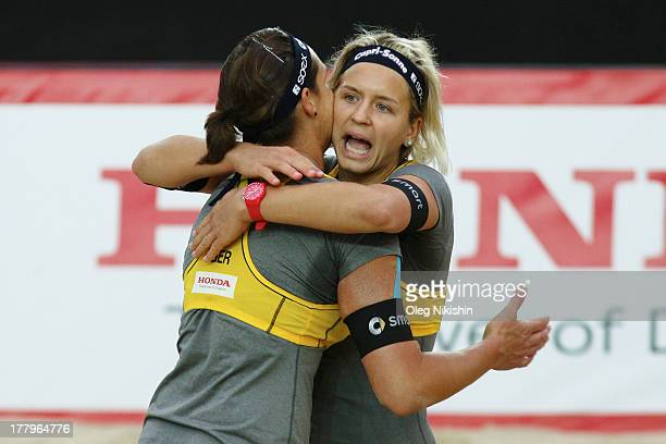 Kira Walkenhorst and Laura Ludwig of Germany react during World Tour Moscow Grand Slam on August 25 2013 in Moscow, Russia.