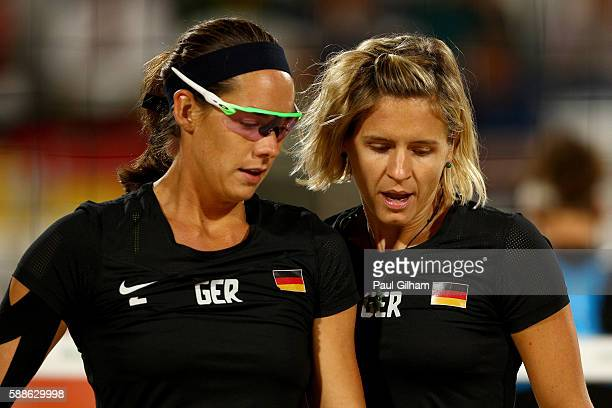 Kira Walkenhorst and Laura Ludwig of Germany talk as they take on Marta Menegatti and Laura Giombini of Italy during the Women's Preliminary Pool D...