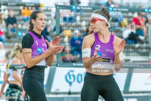 Kira Walkenhorst of DJK TuSA 06 Duesseldorf and Anna-Lena Gruene of MTV 48 Hildesheim looks on during the quarter final match against Margareta...
