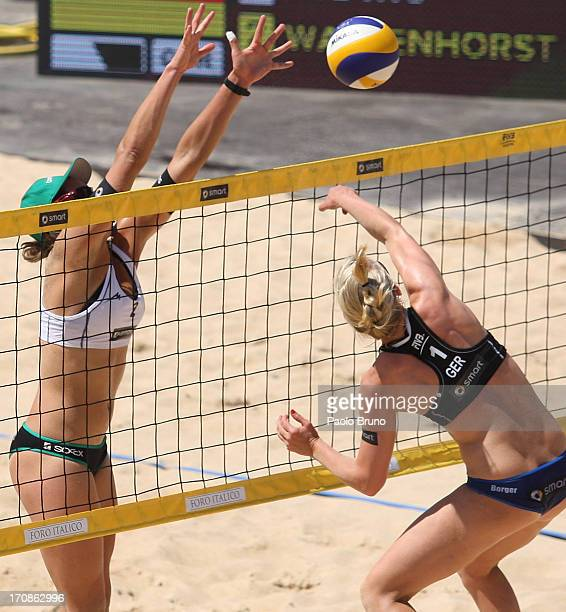 Kira Walkenhorst of Germany blocks as Karla Borger of Germany spikes the ball during the women's main draw of FIVB Smart Grand Slam at Foro Italico...