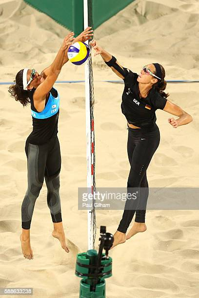 Kira Walkenhorst of Germany is blocked by Laura Giombini of Italy during the Women's Preliminary Pool D on Day 6 of the Rio 2016 Olympics at the...