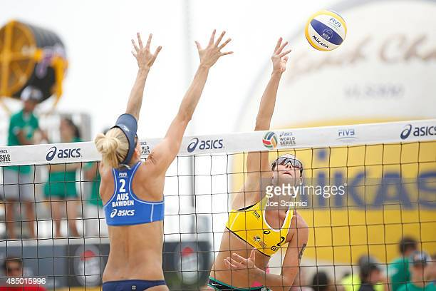 Kira Walkenhorst of Germany sends the ball over the net against Louise Bawden of Australia during the Bronze Medal match at FIVB Long Beach Grand...