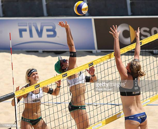 Kira Walkenhorst of Germany spikes the ball as Britta Buthe of Germany blocks during the women's main draw of FIVB Smart Grand Slam at Foro Italico...