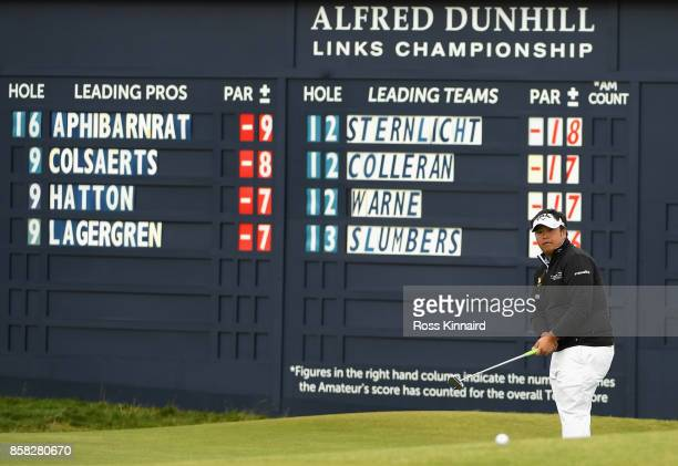 Kiradech Aphibarnrat of Thailan plays his third shot on the 17th during day two of the 2017 Alfred Dunhill Championship at The Old Course on October...