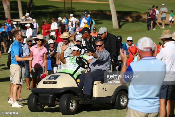 Kiradech Aphibarnrat of Thailand acknowledges spectators after winning the final match against James Nitties of Australia while being driven back to...