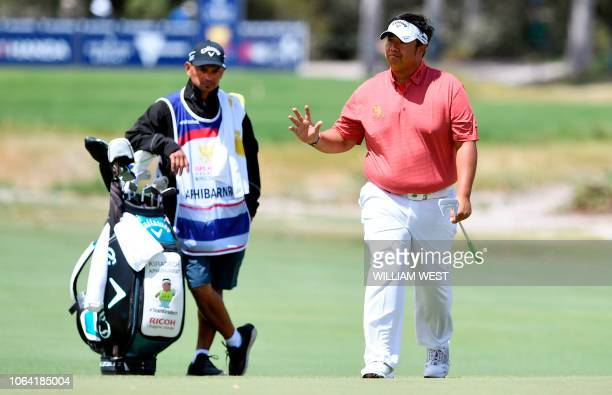Kiradech Aphibarnrat of Thailand acknowledges the applause on the first day of the World Cup of Golf at the Metropolitan Golf Club in Melbourne on...
