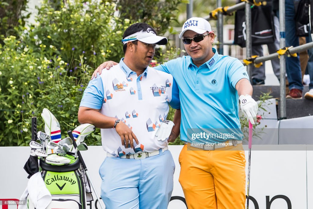 Kiradech Aphibarnrat (l) of Thailand and Angelo Que of Philippines chat before teeing off during round three of the UBS Hong Kong Open at The Hong Kong Golf Club on November 25, 2017 in Hong Kong, Hong Kong.