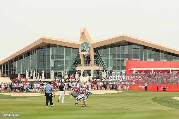 Kiradech Aphibarnrat of Thailand and Martin Kaymer of Germany approach to the 9th green during the final round of the Abu Dhabi HSBC Championship at...