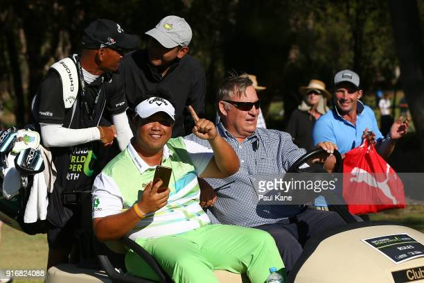 Kiradech Aphibarnrat of Thailand celebrates winning the final match against James Nitties of Australia while being driven back to the 6th green...