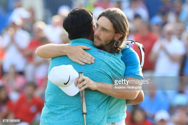 Kiradech Aphibarnrat of Thailand embraces Tommy Fleetwood of England on the 18th green during the final round of the DP World Tour Championship at...