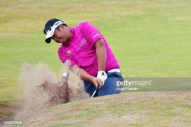 Kiradech Aphibarnrat of Thailand hits a bunker shot on the 18th hole during the third round of the 147th Open Championship at Carnoustie Golf Club on...