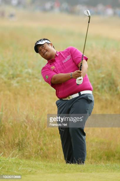 Kiradech Aphibarnrat of Thailand hits a shot from the rough on the sixth hole during the third round of the 147th Open Championship at Carnoustie...