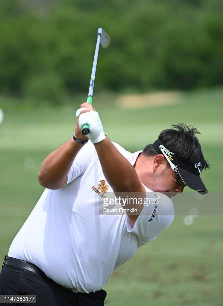Kiradech Aphibarnrat of Thailand hits a shot on the driving range prior to the start of the ATT Byron Nelson on May 06 2019 in Irving Texas
