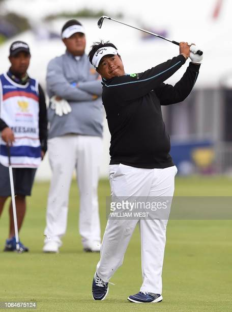 Kiradech Aphibarnrat of Thailand hits to the green on the third day of the World Cup of Golf at the Metropolitan Golf Club in Melbourne on November...